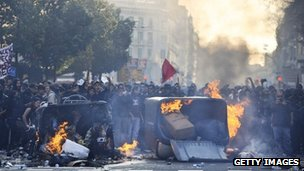 Demonstrators set fire to garbage containers during heavy clashes with riot police during a 24-hour strike on 29 March, 2012 in Barcelona, Spain. 