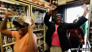 Tammy Redlen (C) and Sierra Luchien (L) are jubilant as they walk in Blue Bird liquor store after waiting in line for nearly three hours to purchase their Mega Millions lottery ticket on March 29, 2012 in Hawthorne, California.