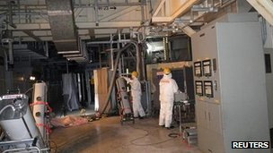 Workers check radiation levels inside the primary containment vessel at Fukushima, 28 March 2012