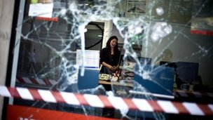 Broken window in Barcelona after Thursday's anti-austerity protests