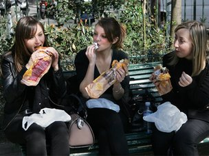 Girls eating lunch in park