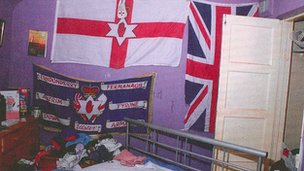 Bedroom of one of the accused with Loyalist flags on wall