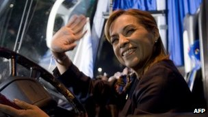 Josefina Vazquez Mota sitting at the wheel of a bus, waving.  30 March 2012