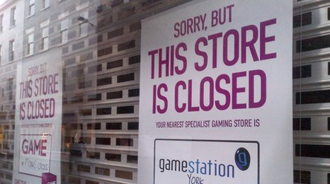 A closed sign on a Game store