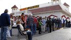 People wait for hours outside the Primm Valley Lotto Store near the Nevada border in Primm, Nevada 29 March 2012