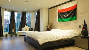 Bedroom with new Libyan flag hanging over the bed