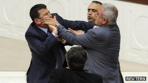Members of Turkey&#039;s parliament fight during the debate on the Education Reform Bill