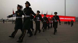 Paramilitary policemen patrol on Tiananmen Square - archive image