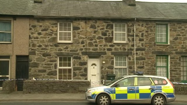 North Wales police have launched a major inquiry after the bodies of a woman and a child were found at a house