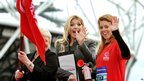 Princess Beatrice (right) with TV presenter Holly Willoughby wave off runners at the start of the National Lottery Olympic Park run