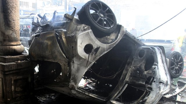 Wreckage of car after bomb attack in Yala province, Thailand