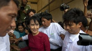 Burma's opposition leader Aung San Suu Kyi (R) is surrounded by supporters and journalists - 1/4/12