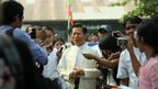 Former Myanmar prime minister and military intelligence chief Khin Nyunt arrives at a Rangoon polling station