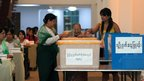 A woman casts her vote in Rangoon