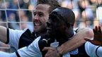 Papiss Cisse (right) celebrates scoring for Newcastle