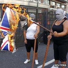 Activists in Argentina burn the Union Jack flag