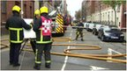 Firefighters at Bass Buildings in Alfred Street