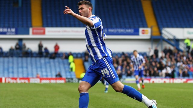 Gary Madine celebrates one of his two goals for Sheffield Wednesday against Preston