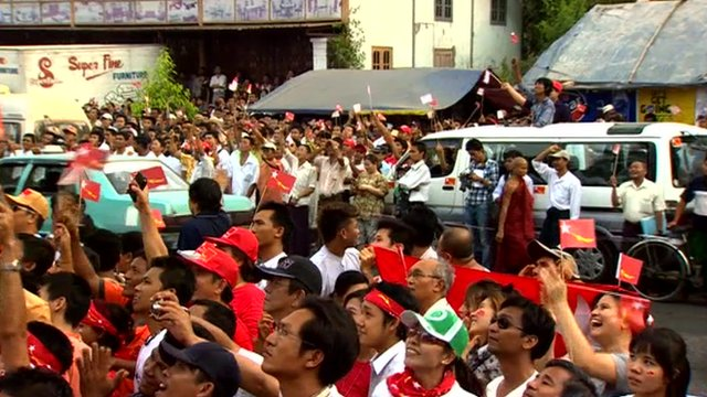 Party supporters celebrate outside the NLD's headquarters in Rangoon