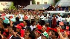 Party supporters celebrate outside the NLD&#039;s headquarters in Rangoon