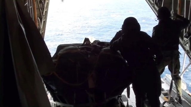 The US coastguard drops medical supplies to the Geraldton Western Australia yacht on the Pacific Ocean