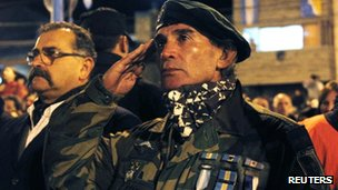 Falklands War veteran Cesar Ozan salutes during a ceremony on the eve of the 30th anniversary of the war, in Ushuaia.