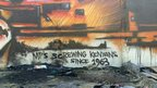 """MPs screwing Kenyans since 1963,"" reads this mural"