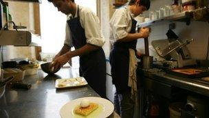 Kitchen staff prepare meal