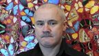 Damien Hirst in front of his I Am Become Death, Shatterer of Worlds 2006 artwork