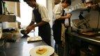 Staff preparing desserts