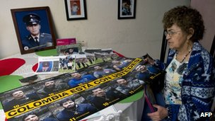 Maria Virginia Franco, mother of Sgt Beltran, next to a banner of the hostages on 30 March 2012