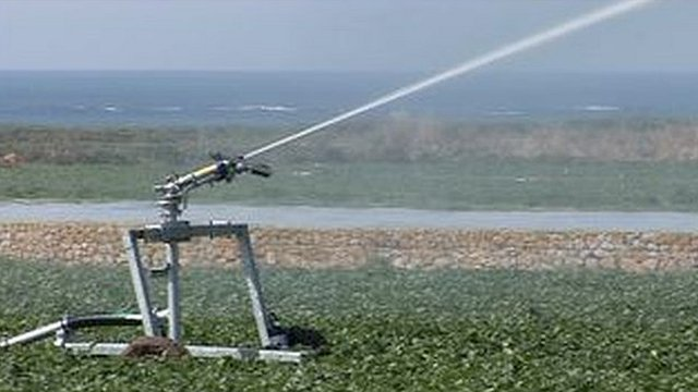 Irrigating a field in St Ouen
