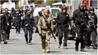 Armed emergency responders at the scene of a shooting at Oikos University in Oakland, California 2 April 2012