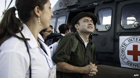 Handout photo released by the International Committee of Red Cross (ICRC) of former FARC hostage Cesar Augusto Lasso Monsalve (right)