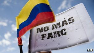 """Colombian national flag and a banner that reads """"No More Farc"""" during a demonstration in November 2011"""