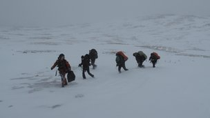 Climbers being led to rescue helicopter in the Ben Macdui area