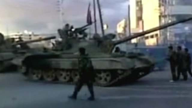 Syrian tanks and troops