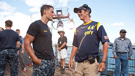 Taylor Kitsch and Peter Berg on the set of Battleship
