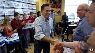 Mitt Romney shakes a voter&#039;s hand in Waukesha, Wisconsin on 3 April 2012