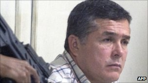 Alleged Guatemalan drug trafficker Horst Walther Overdick under armed guard in Guatemala City.