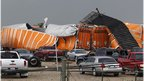 Semi-tractor trailers lay in debris field left by a tornado which passed through the southern area of Dallas, Texas on 3 April 2012