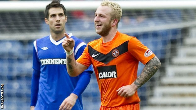 Johnny Russell (right) scored in United&#039;s cup victory at Ibrox