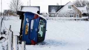 An overturned car in Anfield Plain, County Durham