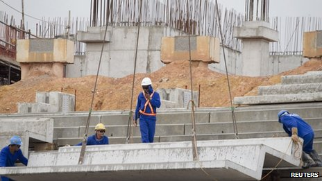 Labourers work on the site of the new Arena da Amazonia stadium, one of the hosts of the 2014 World Cup, in Manaus, the heart of the Brazilian Amazon March  2012.