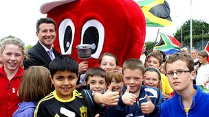 Lord Sebastian Coe with Flames project children
