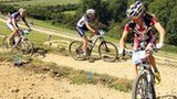 Catharine Pendrel (gold) of Canada leads Julie Bresset (bronze) of France and Georgia Gould (silver) of the USA at the women's mountain biking test event at Hadleigh Farm on 31 July 2011