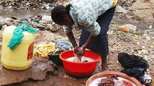 Woman washing clothes in the Kibera slum of the Kenyan capital, Nairobi