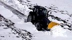 Tractor clears the snow