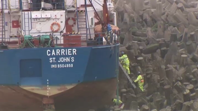 Salvage experts board the stricken cargo ship MV Carrier at Llanddulas, near Colwyn Bay