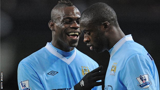Manchester City's Mario Balotelli and Yaya Toure